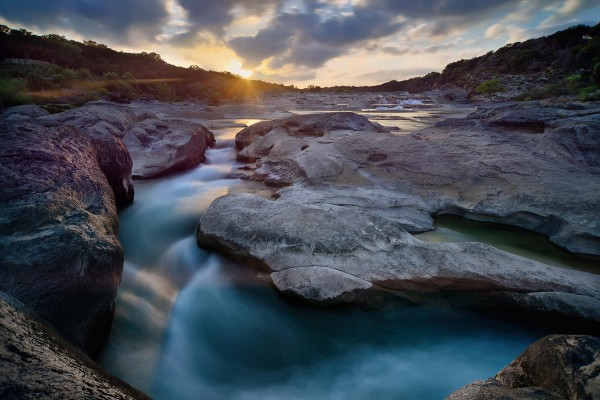 Jacobi Ben Sunset on the Pedernales River in the Texas hill country.