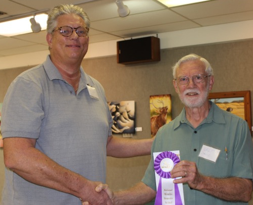 Juror Walt Davis presents Best of Show to Steve Danner